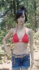 Zoe the model is wearing a crocheted red bikini top