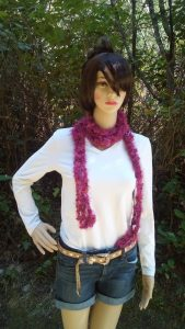 Zoe the model is wearing a crochet scarf