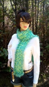 Zoe the model is wearing a crochet granny square scarf