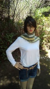 Zoe the model is wearing a crochet and knit scarf