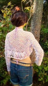 Zoe the model is wearing a crochet Sleeve-Shawl