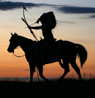 This is a silouette of an indian on a horse