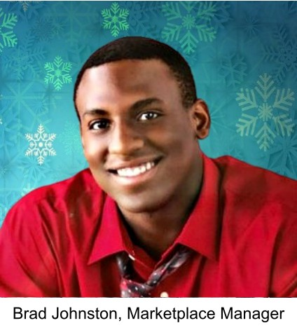Photo of the Marketplace Manager, Brad Johnston. He is wearing a deep red shirt, against a blue snowflake background.