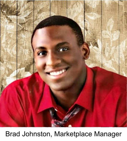 Photo of the Marketplace Manager, Brad Johnston. He is wearing a deep red shirt, against a woodgrain with leaves background.